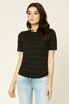 A stretch-knit tee featuring an allover metallic stripe pattern, short sleeves, a round neckline, and a boxy silhouette.
