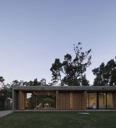 permeable house in uruguay features a slatted timber folding facade by MASA arquitectos