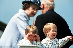Queen Elizabeth II enjoying a day out with two of her grandchildren Prince William and Prince Harry in 1987
