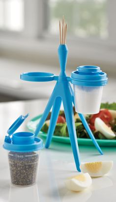 Tupper™ Minis Salt and Pepper Shakers with Caddy. Shakers match Caspian Flora Lunch Set when you're on the go. And at home, caddy keeps salt and pepper visible on the table. Exclusive offer, only available at a Tupperware Party.