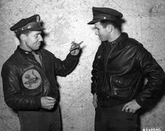 1st Lt. G.B. McIntosh, right, Dallas, Texas, tells Capt. O.V. Jones, Albany, Georgia about his mission over Frankfurt, Germany, after his return to their base in Ridgewell, England.  This is the first mission that Lt. McIntosh has flown since his return from an internment camp in Sweden, where he and Capt. Jones were forced down after participating in a raid on Norway, 24 July 1943.  30 January 1944.