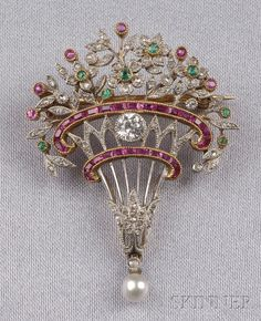 Edwardian Diamond and Gem-set Brooch, France. Designed as a flower basket, set with old European and rose-cut diamonds, ruby, and emerald highlights.