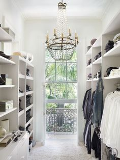 A clean, white modern french closet. An antique French chandelier hangs in the closet of a New Orleans house by Lee Ledbetter. Closet Designs and Dressing Room Ideas Photos Master Closet, Closet Bedroom, Closet Space, Master Bedroom, Hallway Closet, Extra Bedroom, Closet Doors, Master Suite, Bedroom Decor