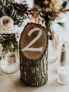 15 Unique Wedding Table Numbers We'll Help You Recreate Table Numbers For Wedding, Diy Wedding Table Decorations, Unique Table Numbers, Wedding Table Number Holders, Rustic Table Numbers, Wedding Centerpieces, Rustic Table Settings, Rustic Table Decorations, Wedding Table Settings