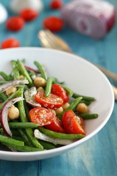 A fresh spring salad with garlic dill green beans, red onions, tomatoes, and chickpeas. #vegan