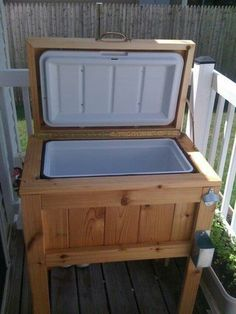 DIY cooler stand for your deck. Add chalk paint or hang a chalk board to the front and write what drinks are in there. Add spout to side or bottom to drain