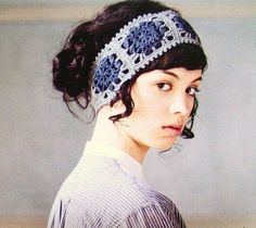 crocheted head band - want to make one that is all white - I even have the yarn for it already.