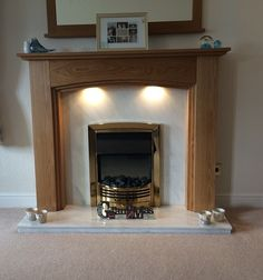 The Lyndhurst Oak sent in by Shona Hamilton made to fit around an existing marble set with the accompaniment of downlights. Oak Fire Surround, Fireplace Surrounds, Downlights, Solid Oak, Hamilton, Bungalow, Marble, Park, Fit