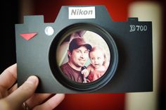 https://flic.kr/p/9UaZBw | Father's Day card | O.k. so I saw this idea in Family Fun magazine and I knew it would be the perfect father's day card.  I cut out the shape of a camera (I have a cricut machine that did it) then I spray painted a peanut butter lid black for the lens. I used a silver pen for the D700, a rhine stone for the AF assist, and I just cut out the Nikon from a magazine ad.   You still have time to make this for all  those dad's into photography.  P.S. not the best pic of…