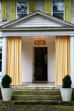 I love how the Novogratz (House by Novogratz on HGTV) hung outdoor curtains on their front porch.  What a fun way to dress up an entryway with color.