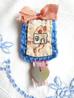 Crochet and hand dyed fabric with an embroidered house - Brooch