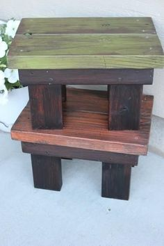 footstool: looks simple enough to make, using 2*4's cut to size. Paint the tops different from the legs (would do ahead of time, before screwing together). COuld use as a centerpiece that can be taking home (or donated/sold)