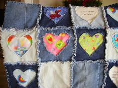 "This two layer quilt is made from blue jeans, with peek a boo windows cut out in the shape of hearts to reveal happy children playing, animals, angels, toys, and other bright and cheerful fabrics and scriptures taken from I Cor 13: 4-8, known as the love scriptures. It is backed with blue flannel with a variety of cozy & cute cats. It is machine washable and dryable and will fray up more with each washing. Use cool water. The size is approximately 42"" x 48"" and is made in a smoke free and..."