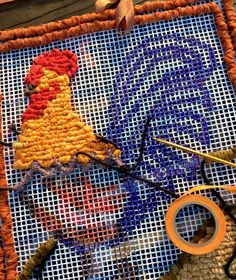 Locker hooking a Phoenix Rooster - by Theresa Pulido