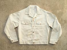 Super clean white denim Roebuck jean jacket made of SELVEDGE denim! Lovely shiny copper color buttons and rivets. Two chest pockets, no hand pockets. Appears to never have been worn, though the tags have been cut off. Estimated size mens medium. Measurements: Width underarm to underarm: