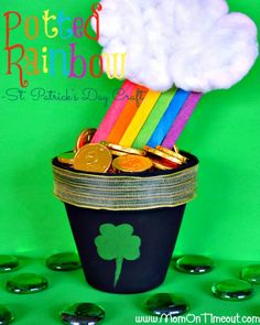 Pot of Gold Activities - terra cotta pot with rainbow popsicle sticks.