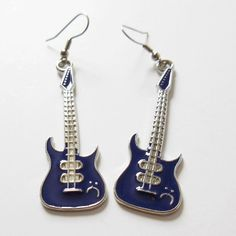 Check out this item in my Etsy shop https://www.etsy.com/listing/277615112/guitar-earrings-purple-enamel-guitar