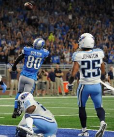 Detroit Lions wide receiver Anquan Boldin (80) throws the ball after scoring a touchdown during the first half of an NFL football game against the Tennessee Titans, Sunday, Sept. 18, 2016, in Detroit.