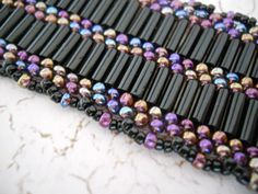 black & iridescent black peyote stitch bracelet, hand woven from seed beads