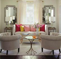 Ideas for pillow arrangement/colour-scheme on couch. Love the monochromatic look to this room, with the added 'punch' of colour on the couch.