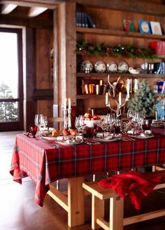 Williams Sonoma Tartan Table. Nice for a cozy cabin table setting . . .you can also get this look on the table with a vintage plaid wool blanket