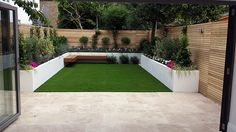 artifical grass easi lawn fake turf raised beds painted white hardwood screen fence trellis wandsworth earlsfield clapham balham london