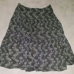 J Crew Skirt Cute J Crew brown with olive green and cream floral print.  skirt. Skirt and lining are 100% cotton . side Zipper and Button. This skirt has been worn but is in great condition. J. Crew Skirts