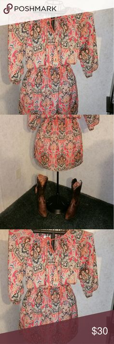 Paisley cowgirl justice dress Sheer paisley cowgirl justice dress silky feel. Colorful and bright. Dress up or down. Perfect with cowboy boots (not included but listed separately) can wear with leggings too! This will be go to dress. Cute tie to neckline. Excellent condition. Smoke free home. Dont remember ever wearing this one. cowgirl justice Dresses