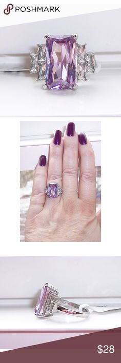 STAINLESS STEEL Simulated Light Amethyst CZ Ring This gorgeous ring has an oblong 16x9mm simulated Amethyst stone with 3 oblong clear AAA Grade Cubic Zirconia stones on each side. Solid TK316 Stainless Steel (no plating) is high polished to a mirror finish. Stainless Steel Jewelry is hypo-allergenic, non tarnish and never turns your finger green. It is a darker metal than sterling silver. If you don't see the size you want please contact me and I will see if I can order one for you, most of