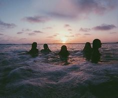 Sunset dip in the ocean.