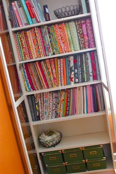 what a great idea to organize all the fabrics!