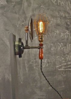https://www.ebay.com/itm/Vintage-Industrial-Cage-Light-with-Wall-Mount-Machine-Age-Trouble-Lamp-Sconce-/200738239109?hash=item2ebcee7285