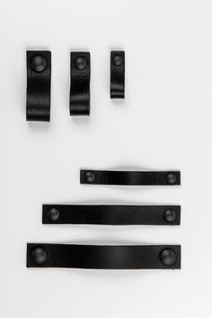 cabinet hardware / drawer pull, leather, black on black by nuinterieurontwerp