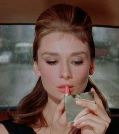 Revlon's Super Lustrous Lipstick in 415 Pink in the Afternoon is supposedly a dupe for the color Audrey Hepburn wears in Breakfast at Tiffany's.