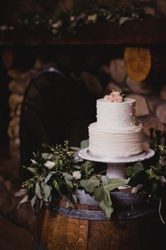 Wine barrel wedding cake table.                                                                                                                                                                                 More