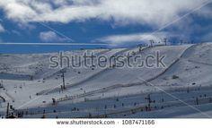 Ski tracks over which a jet plane flies; compre este imagen de archivo (stock) en Shutterstock y encuentre otras imágenes. #snow #photostock