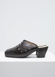 Cuban heel mules with cut out and studded detailing. Leather sole, insole, and lining with rubber sole reinforcement and toe cap. Heeled Mules, Slippers, Footwear, Heels, Leather, Black, Fashion, Heel, Moda