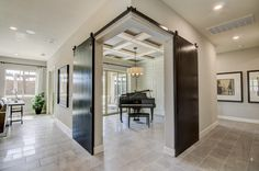 Barn doors at right angles beautifully frame this show-piece piano.