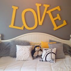 Yellow and grey bedroom! i'm obsessed with this. not ashamed to say i even have a penguin pillow pet to complete it