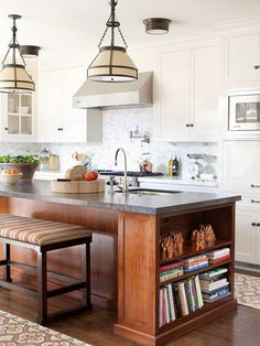 Mismatched cabinetry adds to the country-feel of this kitchen: http://www.bhg.com/kitchen/styles/country/country-kitchen-ideas/?socsrc=bhgpin02072014perfectmatch&page=6