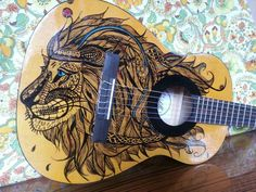 Hand painted guitar with zentangle lion