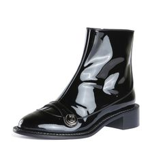 The Rochas Patent Leather Boot is a black mid rise boot. Made of patent leather they feature a round toe, zip closure and a logo snap detail.