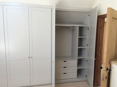 Fitted wardrobes painted in Farrow & Ball Purbeck Stone with internal shelves and drawers