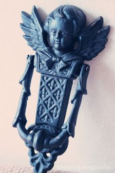 Iron cherub door knocker