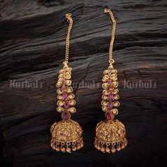 Designer antique jhumka earrings studded with synthetic ruby stones, plated with gold polish and made of copper alloy Jewelry Design Earrings, Gold Earrings Designs, Gold Jewellery Design, Antique Jewellery Designs, Synthetic Ruby, Gold Jewelry Simple, Gold Polish, Antique Earrings, Fashion Jewelry