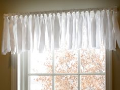 How to make no sew valance by tying strips of material to curtain rod-- this was super easy! i used uneven pieces for my kitchen window. I will definitely use this one again! I will post a picture soon.