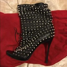 "Christian Louboutin "" Guerilla"" bootie Silver spiked lamb skin bootie purchase at Harrods London. This is a rare item and has protective soles and dust bags.... Worn twice... I also have matching handbag that is a chain strap clutch.... Please feel free to message me with questions... This is a 38 but fits a size 7 Christian Louboutin Shoes Ankle Boots & Booties"