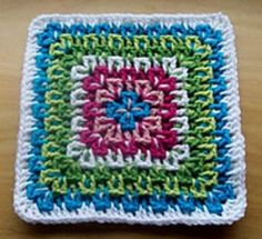 This pattern is a bit of an improvised Granny square, simple to stitch, once you get the hang of it. You can use as few as two colours and as many as eight to achieve the look you're going for. This square looks nice on both sides, if you weave your ends well.
