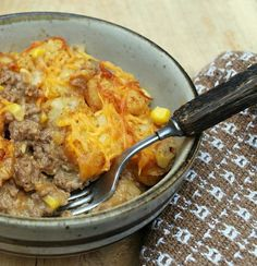 Cowboy Casserole    1 1/2 pounds ground beef (I used 80/20)  1 medium onion, chopped  3 cloves garlic, chopped  1 can (15.25oz) whole kernel corn, drained  1 can condensed cream of mushroom soup  2 cups cheddar cheese, shredded  1/2 cup milk  4 tablespoons sour cream  1 bag (30 oz) frozen tater tots (I used Ore-Ida Crispy Crowns)    Before I got re