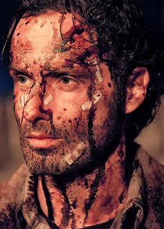"S5 E16  ""Conquer""  Rick covered in blood after killing Walkers that got in after gate was left open by Father Gabriel."